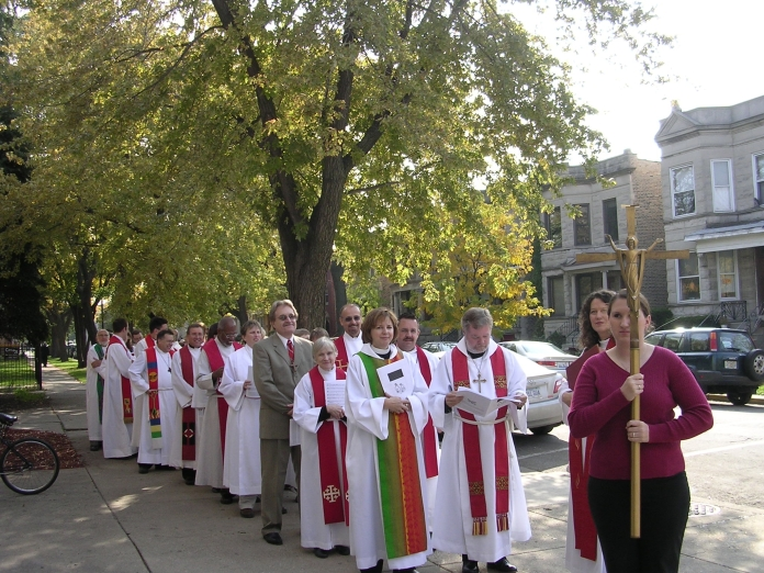 Goddaughter Katie (far right) carries the cross at my ordination, ca. October, 2006.