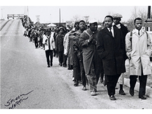 Hosea Williams of SCLC, left, and John Lewis of Student nonviolent Coordinating Connitte leading more than 500 people across Edmund Pettus Bridge (Selma) on March 7, 1965