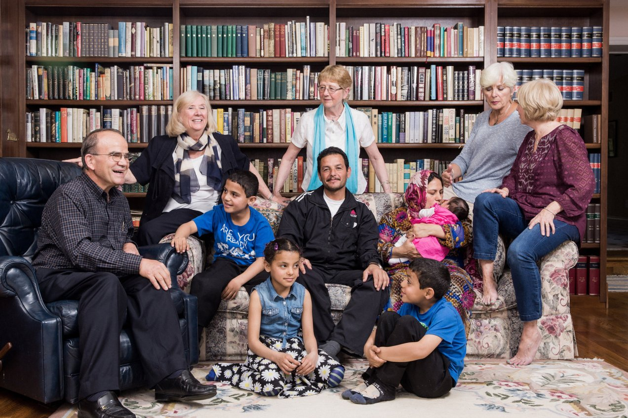 The Ahmed family at the home of Jim and Peggy Karas, left, who were joined by other sponsors. Credit Damon Winter/The New York Times